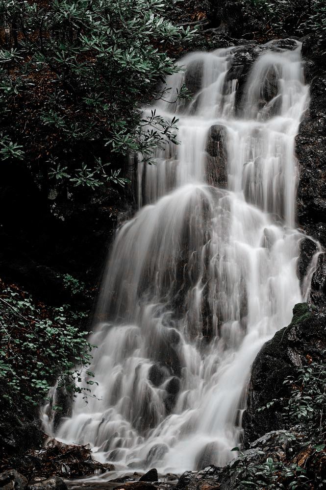 Cataract Falls illuminates the mountain side as it flows down. Exploring Gatlinburg has never been so pretty!